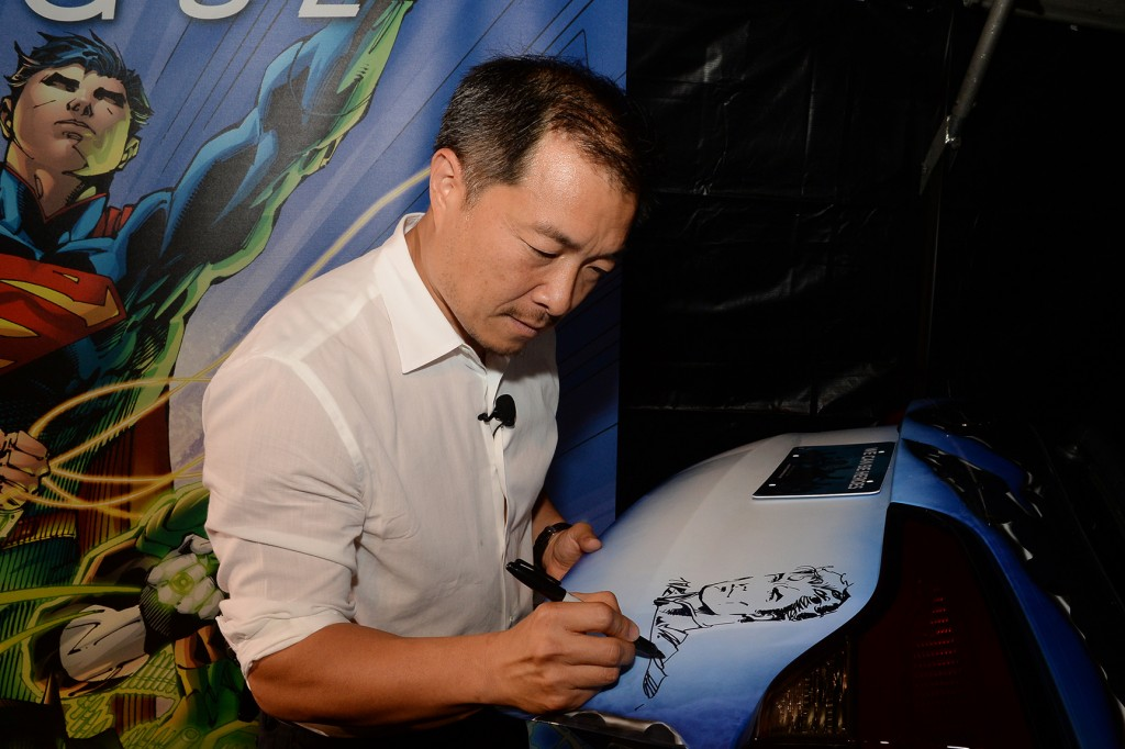 "Jim Lee (creator and co publisher of DC Entertainment) customizes the JUSTICE LEAGUE-inspired Kia Sorento, the eighth and final custom vehicle built in partnership with Kia Motors America, which benefits the ""We Can Be Heroes"" campaign on July 17, 2013."